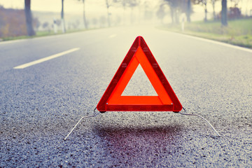 Bad Weather Driving - Warning Triangle on a Misty Road