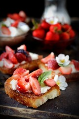strawberries sandwiches with cream cheese and mint closeup