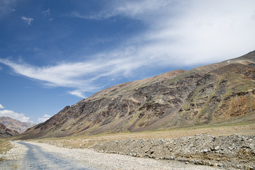 Road among high altitude mountains