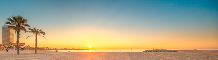 Barceloneta Beach in Barcelona at sunrise