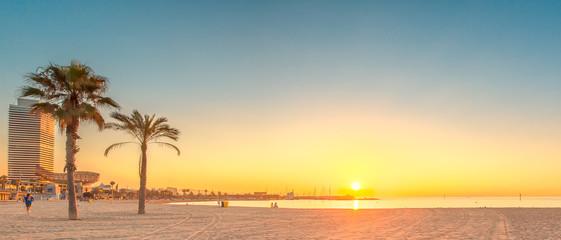 Foto op Canvas Barcelona Barceloneta Beach in Barcelona at sunrise