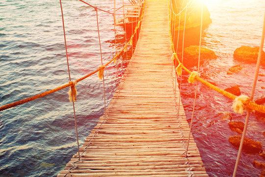 Rope bridge at sunset