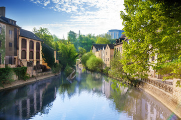 Wall Mural - Houses reflecting in Alzette river, Luxembourg