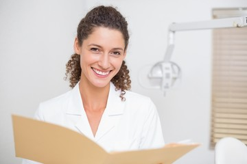 Dental assistant reading from file