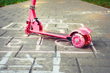 Fototapeten Scooter background of playground with pink little kid scooter and hopsco
