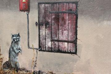 Graffiti im Zoo von Helsinki zeigt Waschbär