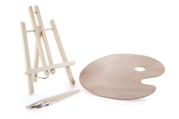 A painter kit, easel and palette isolated on the background.