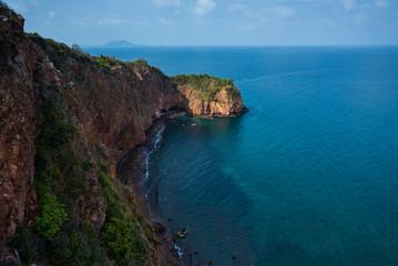 cliff island sea ,Koh Ta Lu, Thailand