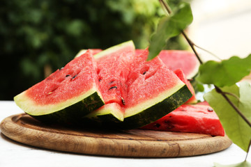 Fresh slices of watermelon on table, outdoors