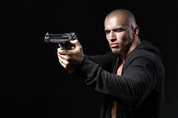man shooting gun isolated on black background