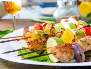 skewers of meat and fresh vegetables