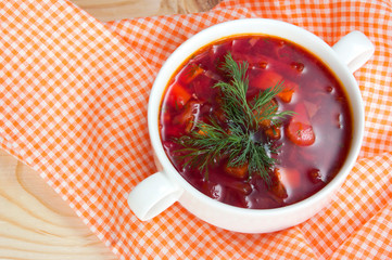 Borsch in white plate isolated on white. Red traditional beetroo