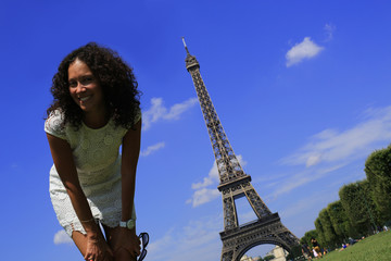 Fototapete - Beautiful girl jumping on the Eiffel tower