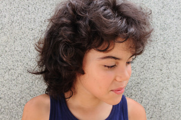 Portrait of an attractive child with curly hair