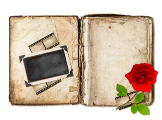 old book with aged pages and red rose flower