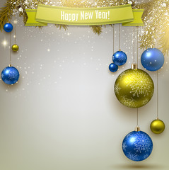 Christmas background with fir twigs and colorful balls. Xmas bau