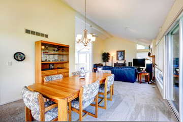 House interior with vaulted ceiling. Dining area