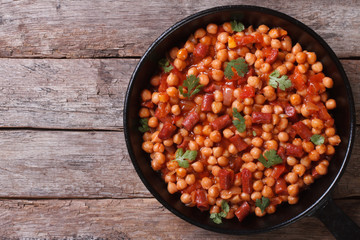 Chickpeas with chorizo ​​in a pan top view