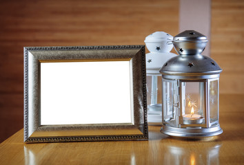 old photo frame on the wooden table against the background of a