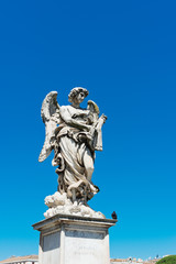 Angel sculpture from St Angelo bridge in Rome, Italy.