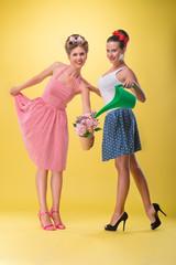 Two beautiful sexy girls with pretty smile wearing dress in pinu