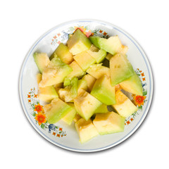 cantaloupe on a plate on white background