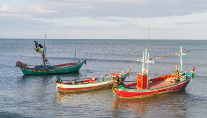 Small fishing boats moored along the shore.