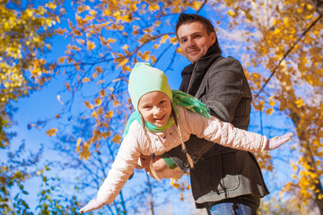 Little cute girl with happy father having fun on sunny day