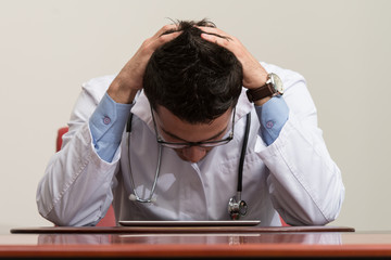 Doctor Having Stress In The Office