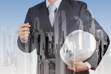 Double exposure of business engineer and abstract city