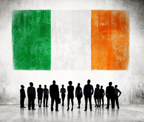 Silhouettes of Business People with Flag of Ireland