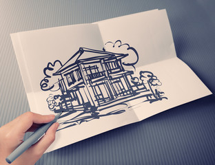 hand drawing house on white folding paper background vintage sty