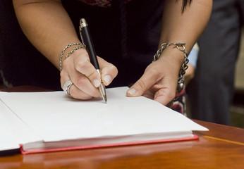 Female signing documents