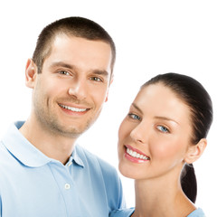 Portrait of young happy smiling attractive couple, isolated on w