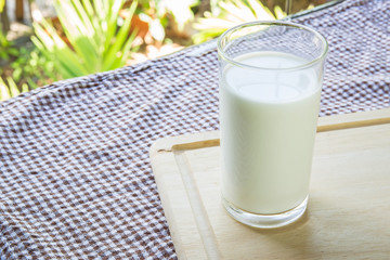 glass with milk on table