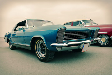 Side view of old luxury car in blue, sixties style, retro
