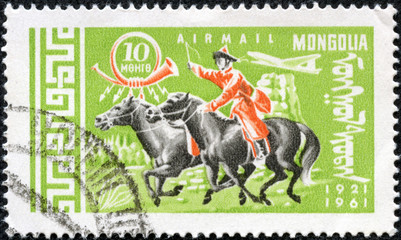 stamp printed in Mongolia, shows Mongolian rider on horse