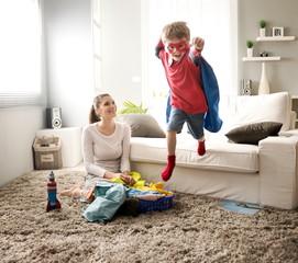 Little superhero helping his mother