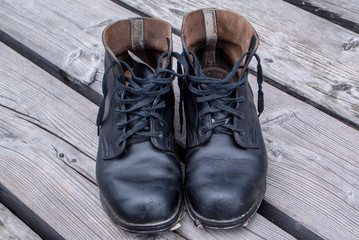 military boots on wood planks