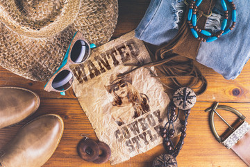Accessories cowboy retro style on wooden surface with wanted pos