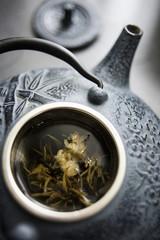 cast iron kettle with green tea, teapot
