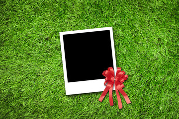 Photo frame on grass background