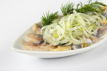 onion circles and dill with herring