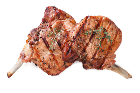 two pieces of of grilled pork isolated on white close up