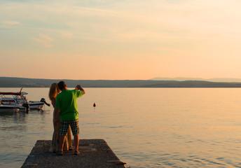 Senior couple in love making photo and enjoying romantic evening
