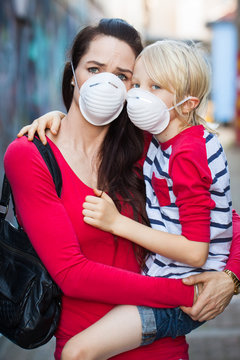 Woman and son wearing face masks