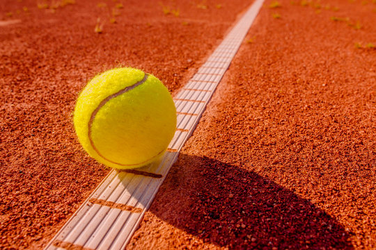 Yellow tennisball on the line