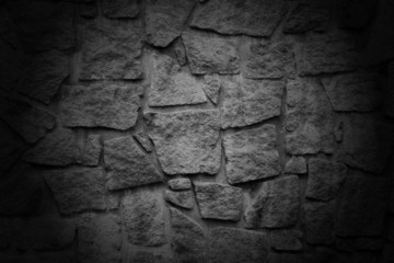Black wall with textured stone blocks