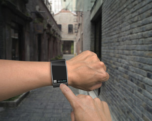 male hand wear iwatch with an index finger