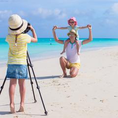 Little girl making photo of her family